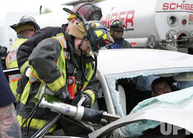 St. Louis Firefighters Work To Free Trapped Driver