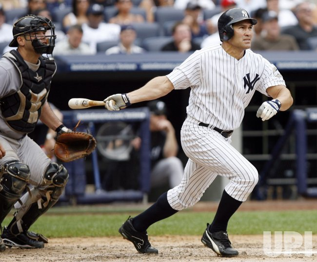 New York Yankees Johnny Damon hits a solo homer against the Toronto Blue Jays at Yankee Stadium in New York