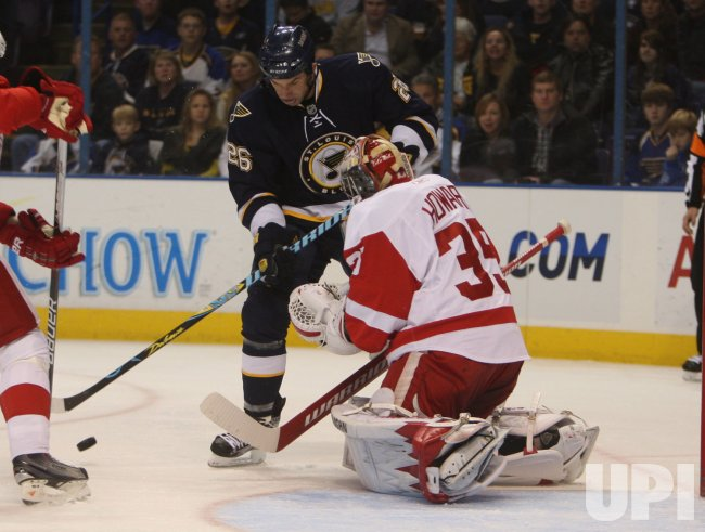 Detroit Red Wings Jimmy Howard and St. Louis Blues BJ Crombeen