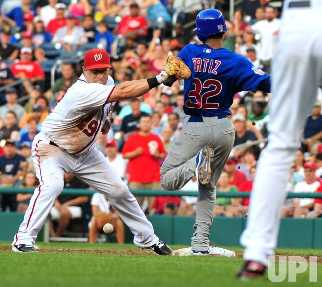 Chicago Cubs pitcher Ramon Ortiz beats the force out in Washington