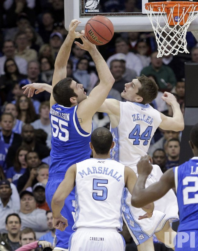 Kentucky Wildcats Josh Harrellson and North Carolina Tar Heels Tyler Zeller at the NCAA East Regional Round of 8 at the Prudential Center in New Jersey