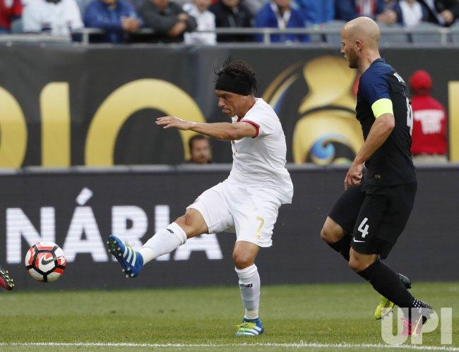 Costa Rica's Bolanos kicks as United States' Bradley defends during Copa America Centario in Chicago