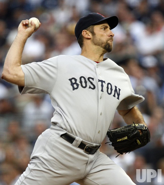 Boston Red Sox starting pitcher John Smoltz throws a pitch against the New York Yankees at Yankee Stadium in New York
