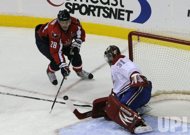 Capitals Semin takes a shot against goalie Price in Washington