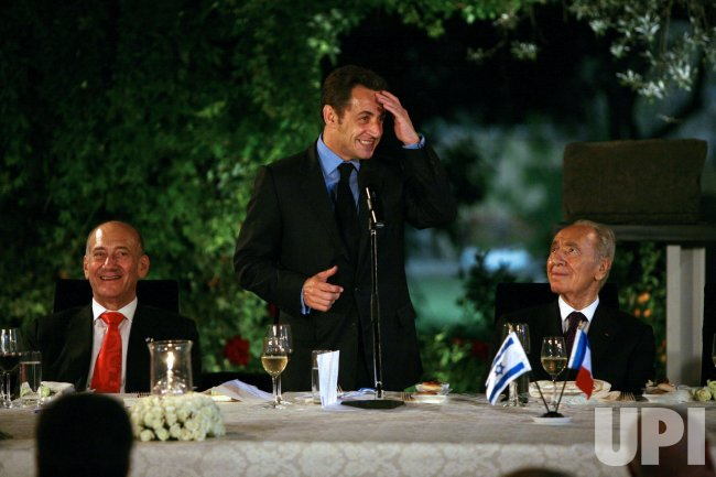 Sarkozy meets with Olmert and Peres in Jerusalem