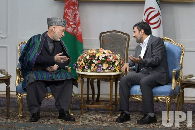 Afghan President Hamid Karzai meets with Iranian President Mahmoud Ahmadinejad