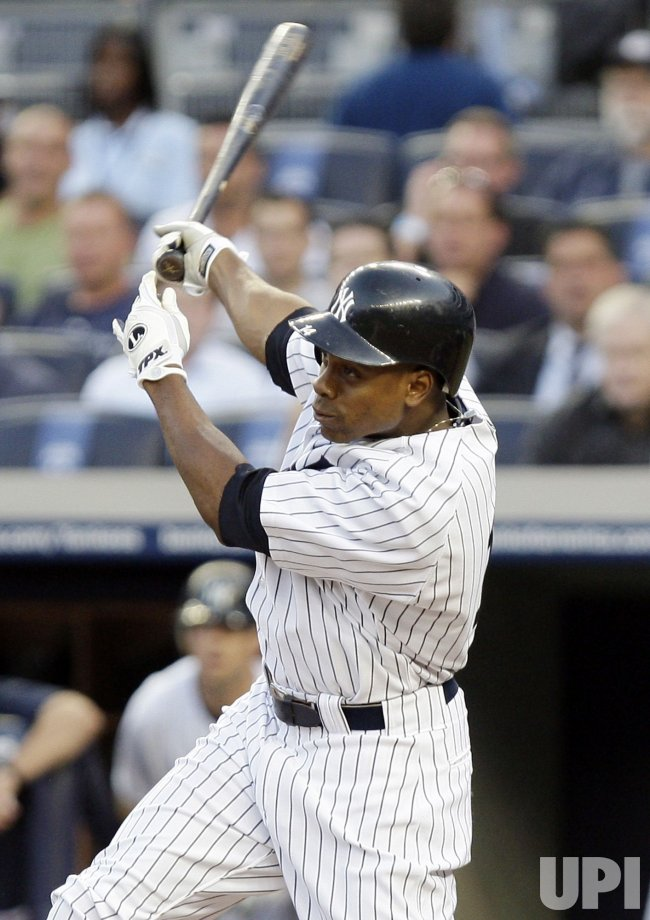 New York Yankees Curtis Granderson drives in 2 runs with a double at Yankee Stadium in New York