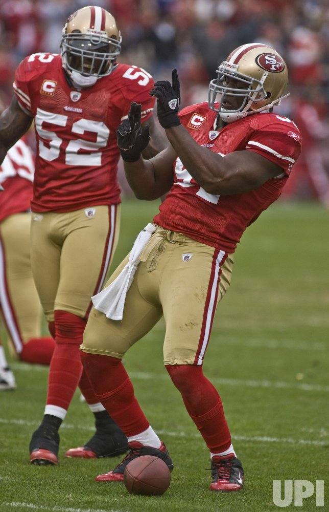 49ers Takeo Spikes makes one of four interception against the Seahawks in San Francisco