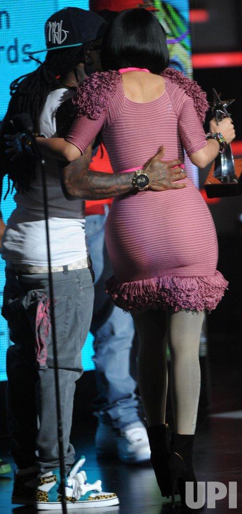 Nicki Minaj and Lil Wayne walk off stage at the BET Awards in Los Angeles