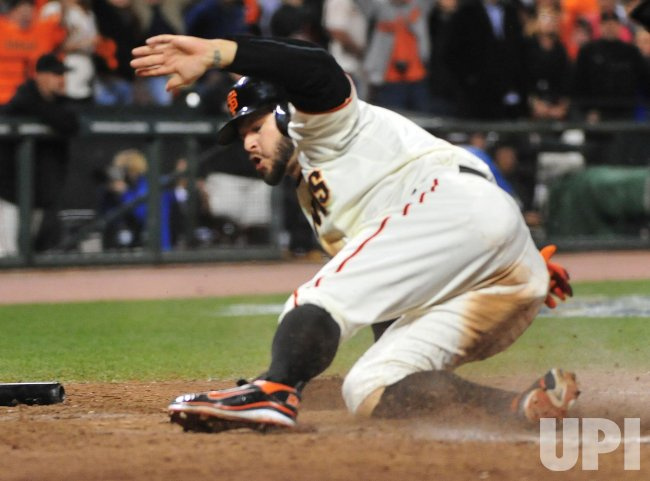 Giants' Cody Ross scores during game 2 of the World Series in San Francisco