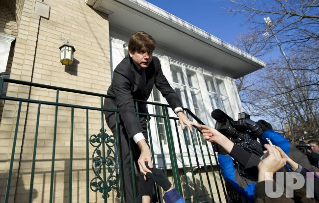 Blagojevich shakes hands after being sentenced to 14 years in prison in Chicago