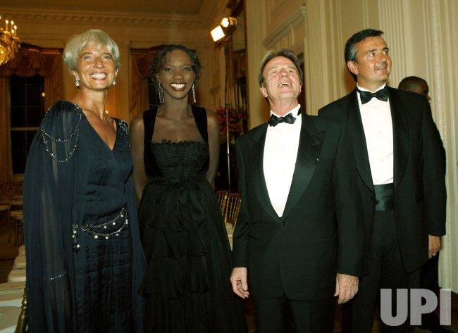 U.S. President Bush hosts French President Sarkozy at White House social dinner.