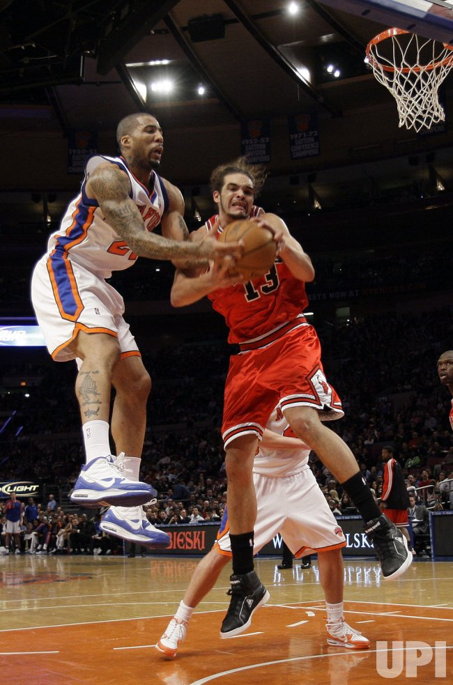 Chicago Bulls Joakim Noah and New York Knicks Wilson Chandler at Madison Square Garden in New York