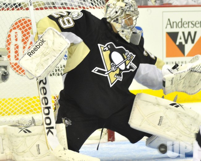 Pens Fleury Makes Saves on Lightnings Moorein Pittsburgh
