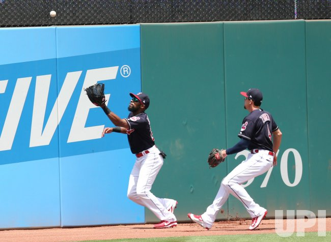 Indians Jackson plays the ball of the wall on a double by Twins Castro