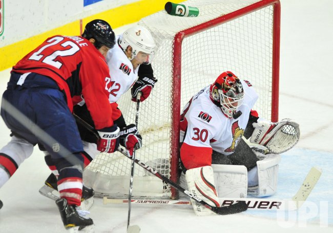 Ottawa Senators' goalie Brian Elliott blocks a shot from Washington Capitals' Mike Knuble in Washington