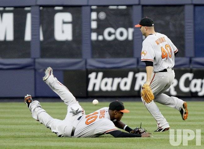 Baltimore Orioles Adam Jones dives for a ball at Yankee Stadium in New York