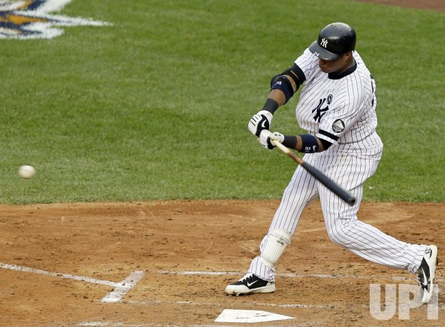 New York Yankees Robinson Cano hits a solo homer in Game 5 of the 2010 ALCS at Yankee Stadium in New York