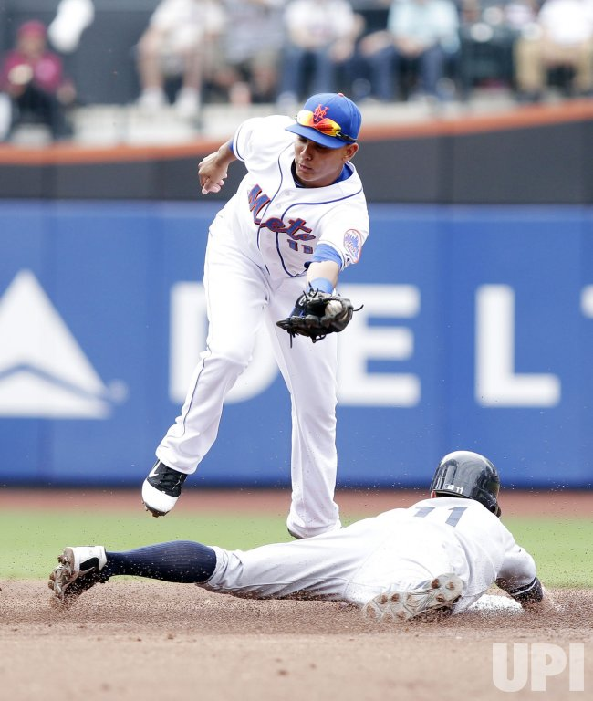 New York Yankees Brett Gardner slides under the tag of New York Mets Ruben Tejada at Citi Field in New York