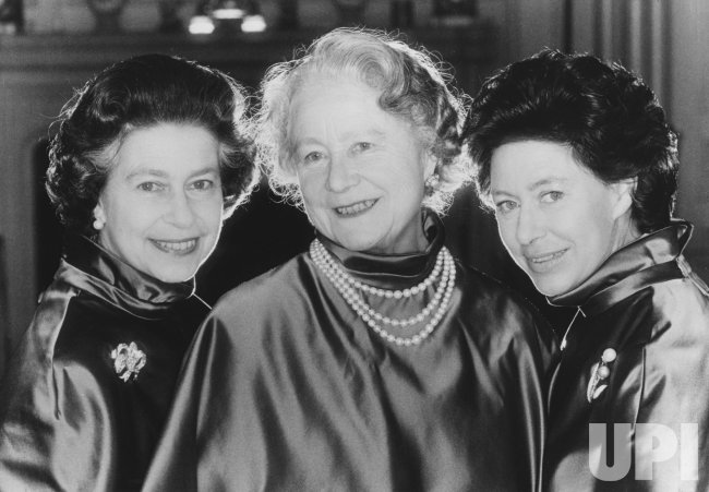 The Queen Mother poses with daughters Elizabeth and Margaret on the occasion of her 80th birthday