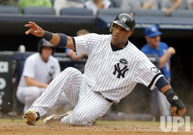New York Yankees Robinson Cano scores a run at Yankee Stadium in New York