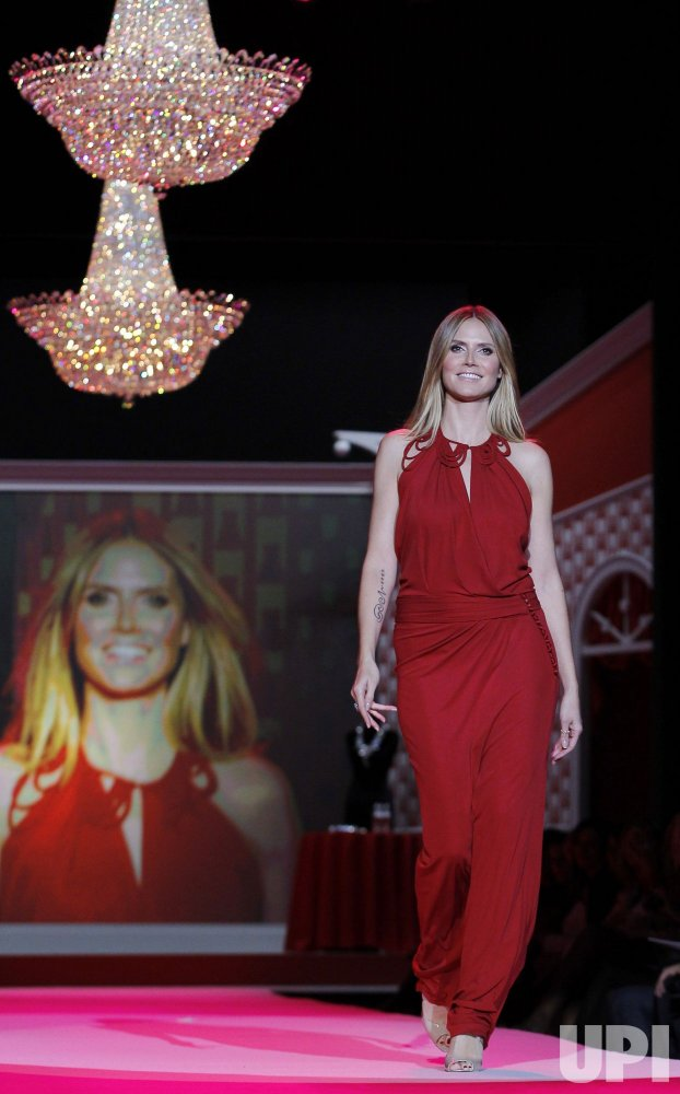 Heidi Klum walks the runway at the The Heart Truth's Red Dress Collection at Mercedes-Benz Fashion Week in New York