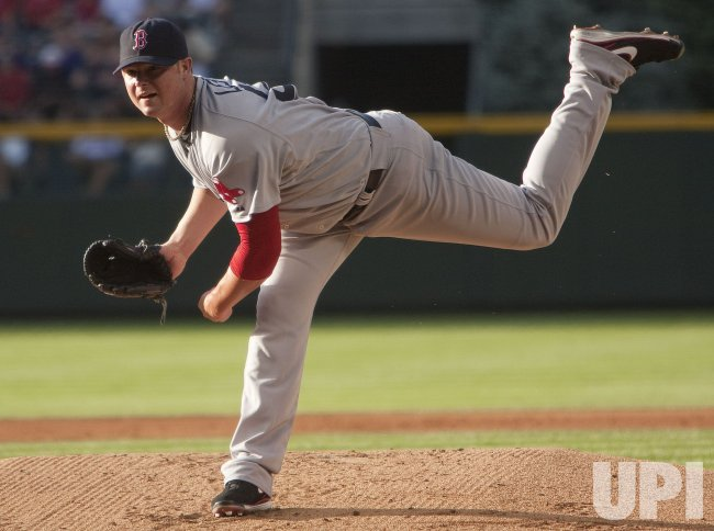 Red Sox Pitcher Lester Pitches Against the Rockies in Denver