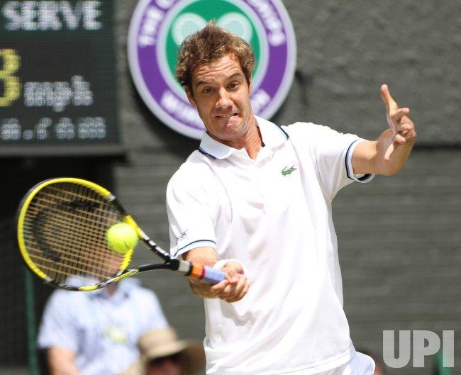 Richard Gasquet returns at Wimbledon.