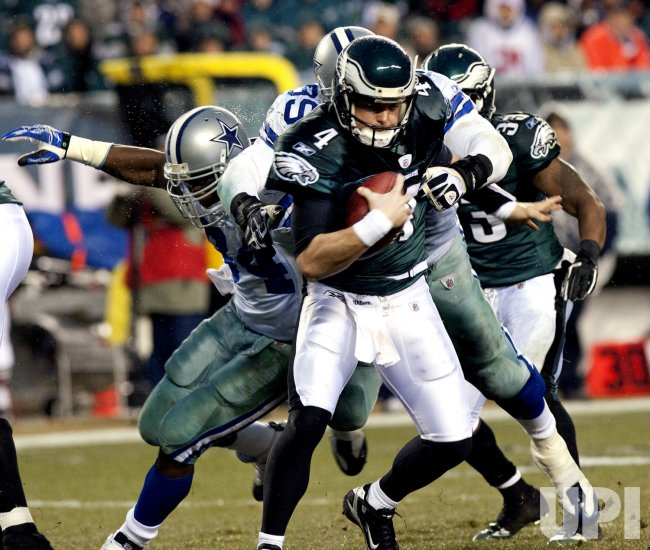 Philadelphia Eagles quarterback Kolb evades a sack attempt in the 2nd quarter.