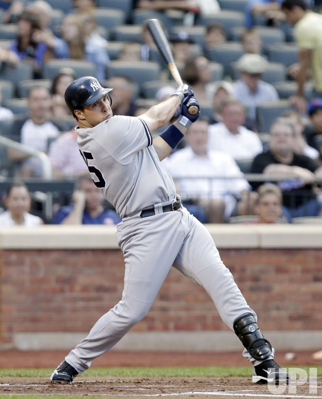 New York Yankees Mark Teixeira hits a double at Citi Field in New York