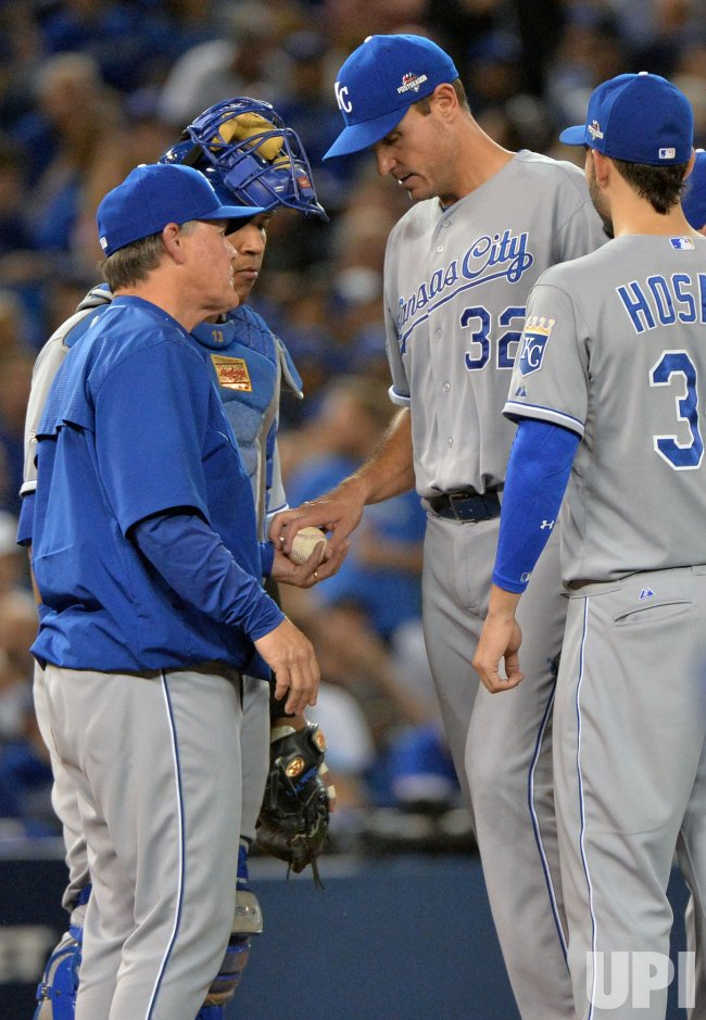 Royals starter Young hands ball to manager Yost