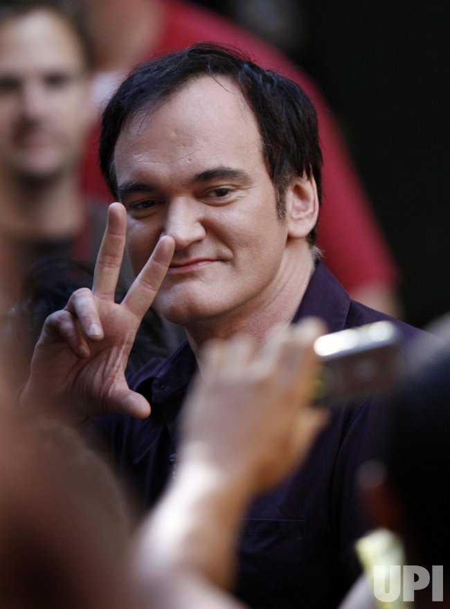 Quentin Tarantino watches Flo Rida perform on the NBC Today Show in New York
