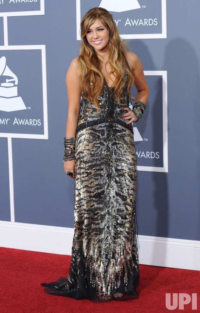 Miley Cyrus arrives at the 53rd Grammy Awards in Los Angeles