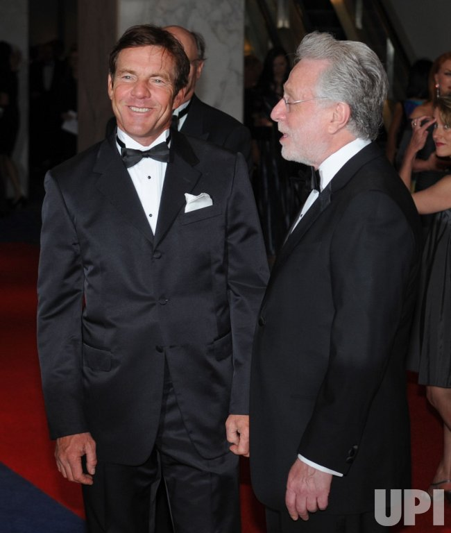 Actor Dennis Quaid and Wolf Blitzer arrive at the White House Correspondents Dinner in Washington
