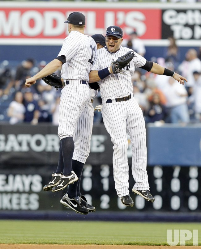 New York Yankees Nick Swisher and Brett Gardner at Yankee Stadium in New York