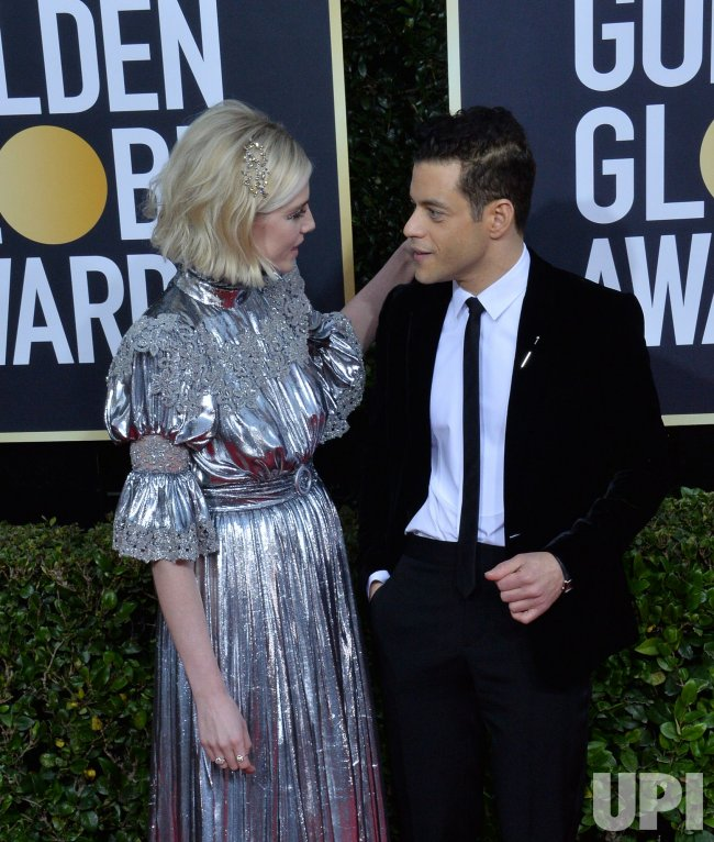 Lucy Boynton and Rami Malek attend the 77th Golden Globe Awards in Beverly Hills