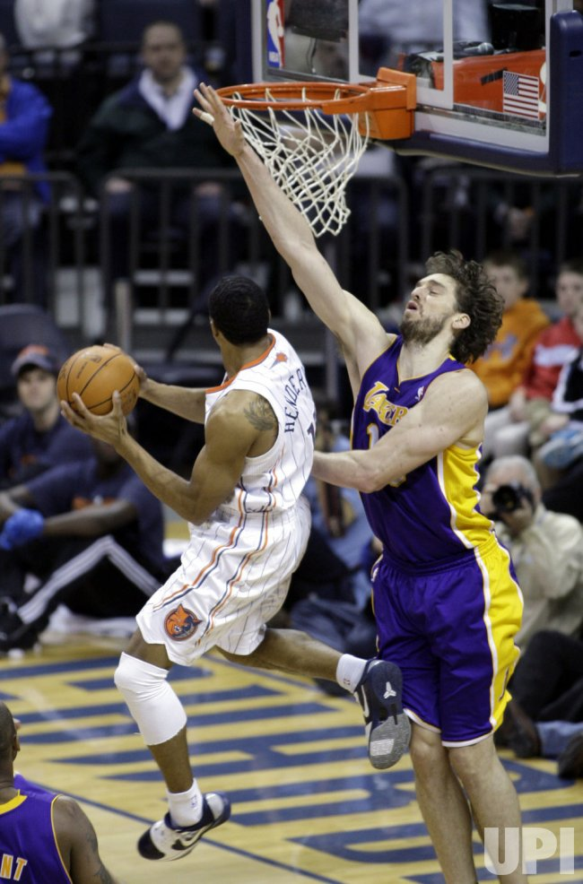 Charlotte Bobcats guard Gerald Henderson shoots over L.A. Lakers' Pau Gasol