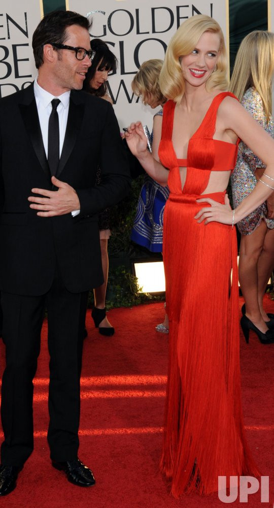 Guy Pearce and January Jones arrive at the 68th annual Golden Globe Awards in Beverly Hills, California
