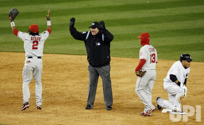 Los Angeles Angels of Anaheim Erick Aybar reacts after New York Yankees Melky Cabrera is called safe at second base in the tenth inning in game 2 of the ALCS at Yankee Stadium in New York
