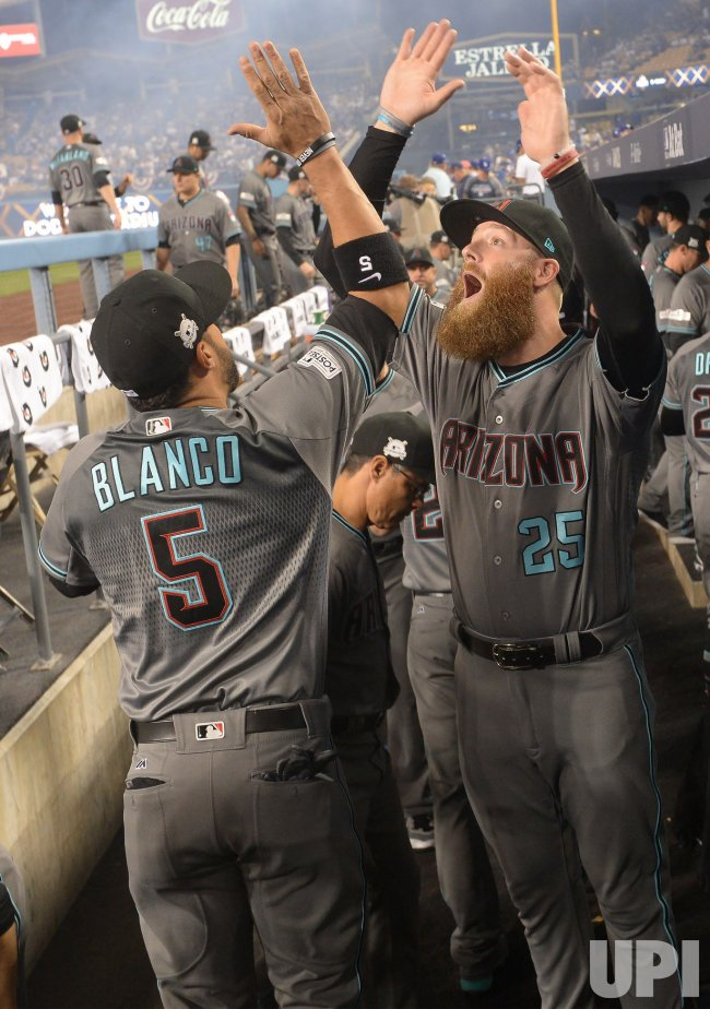 Diamondbacks Blaco and Bradley high five during pre-game in game one of the NLDS against the Dodgers