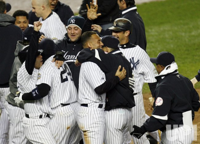 New York Yankees Jerry Hairston Jr.reacts after scoring the winning run in the 13th inning against the Los Angeles Angels of Anaheim in game 2 of the ALCS at Yankee Stadium in New York