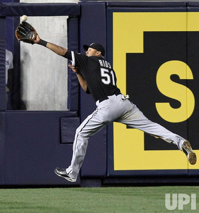 Chicago White Sox Alex Rios makes a catch at Yankee Stadium in New York