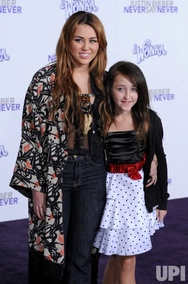 "Miley Cyrus and sister Noah attend the premiere of ""Justin Bieber: Never Say Never"" in Los Angeles"