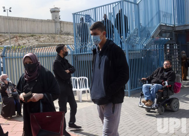Palestinians Wait To Receive The Pfizer-Biotech Coronavirus Vaccine At The Qalandiya Checkpoint