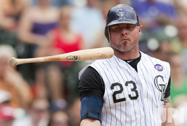 Rockies Giambi Eyes his Flipped Bat After Strikeout Against the Giants in Denver