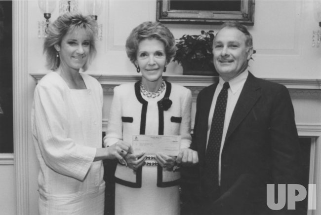 Nancy Reagan and Tom Adams Accept Check from Chris Evert
