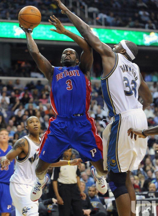 Pistons Stuckey is blocked by Wizards Haywood in Washington