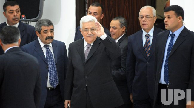 Palestinian President Mahmoud Abbas waves to Israeli peace activists and the press at a meeting in Ramallah, West Bank