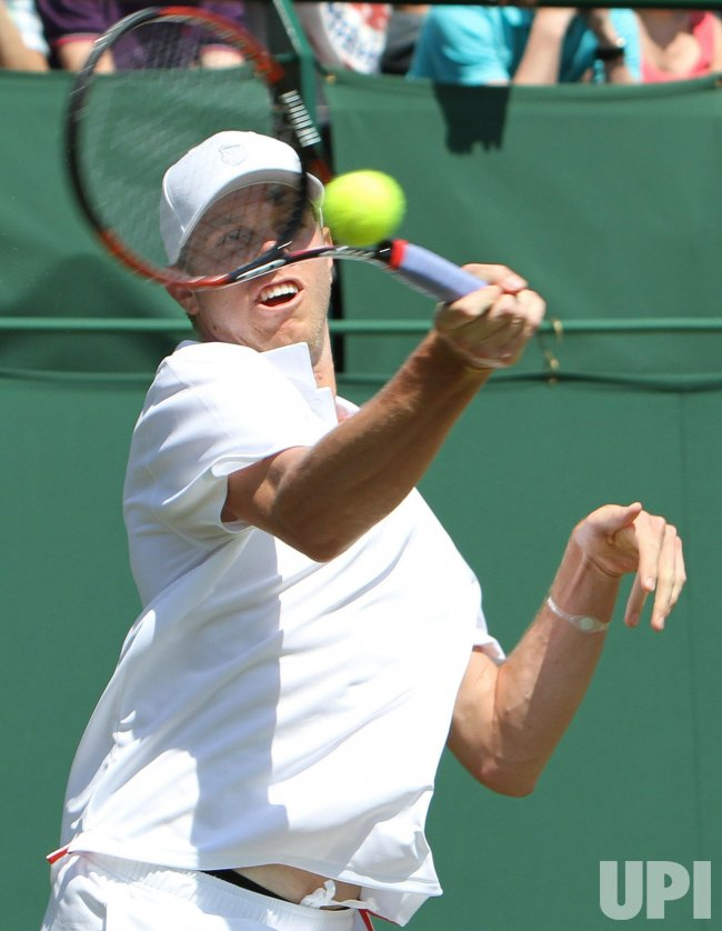 Sam Querrey plays a forehand on the second day of Wimbledon.