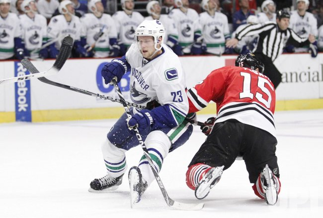 Blackhawks Pisani takes out Canucks Edler in Chicago